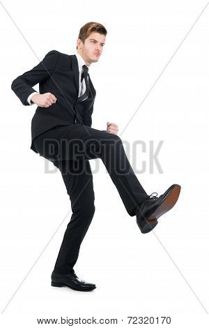 Angry Businessman Kicking