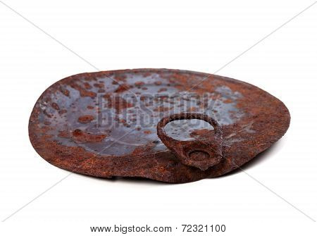 Old Rusty Cap Of Tin Can Isolated On White Backgroun