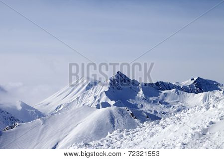 View From Off-piste Slope At Mountains In Fog