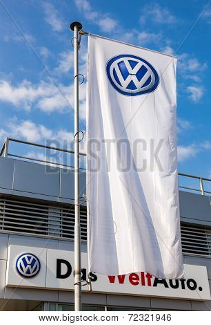 Samara, Russia - September 21, 2014: The Flag Of Volkswagen Over Blue Sky. Volkswagen Is The Biggest