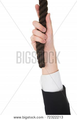 Businessman's Hand Holding Rope