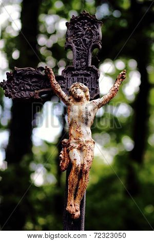 Old brokenness cross with crucifix