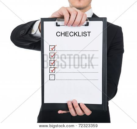 Businessman Holding Clipboard With Checklist