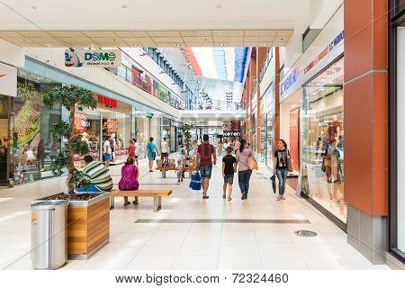 People Shopping In Luxury Mall