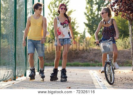 Group Of Friends With Roller Skates In The Park