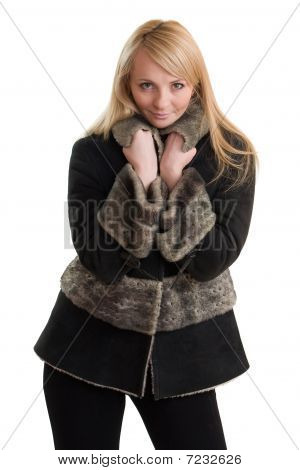 Young Beautiful Woman In Winter Clothes.