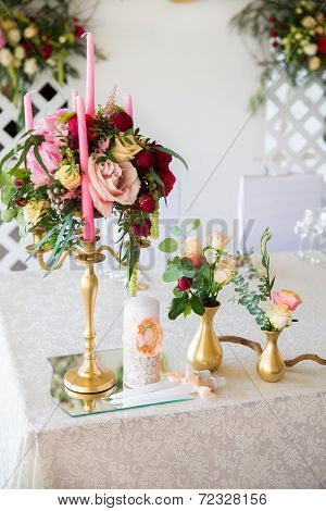 Floral Arrangement To Decorate The Wedding Feast, The Bride And Groom. Flowers, Candles. The Vintage