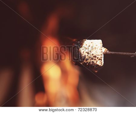 Close Up Of A Marshmallow On A Stick Being Roasted