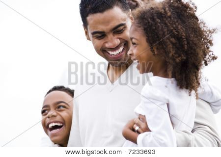 Close-up of African-American father laughing with kids