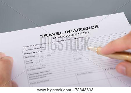 Hand Filling Travel Insurance