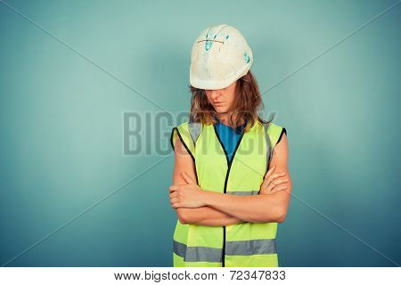 Young Female Engineer In High Vis And Hardhat