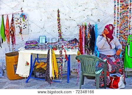 Village woman selling hand-knitted gifts
