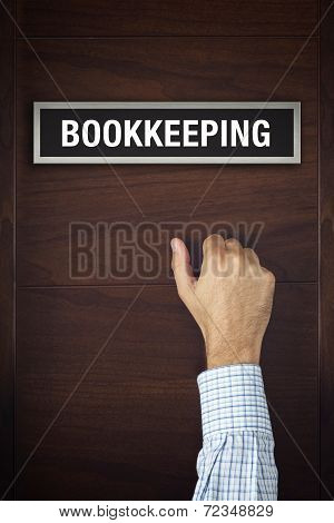 Businessman Knocking On Bookkeeping Office Door