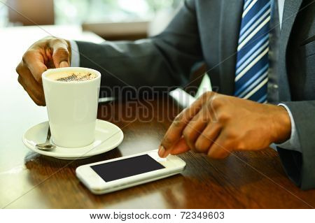 Man Using Mobile Phone In The Coffee Shop