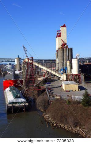 Grain elevator & barge.
