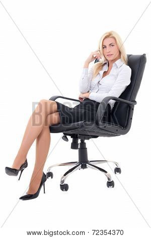 Sexy Business Woman Sitting In Office Chair  Isolated On White