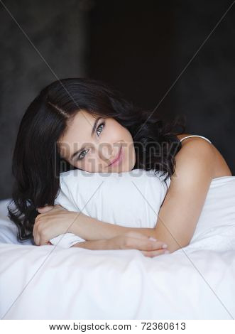 Beautiful woman relaxing in bed.