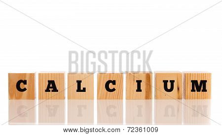 The Word - Calcium - On Wooden Blocks