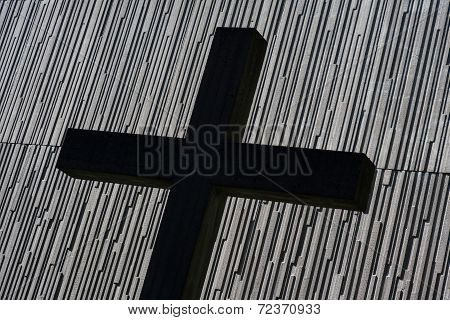 Cross In Front Of Modern Church