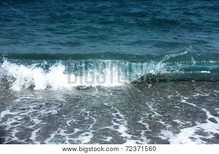 Small waves on shore