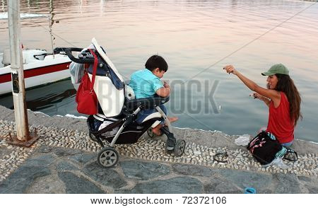 Family fishing on pier