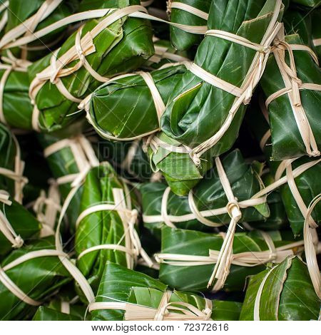 Steamed Sticky Rice In Banana Leaf For Sale At Asian Market. Organic Food Background