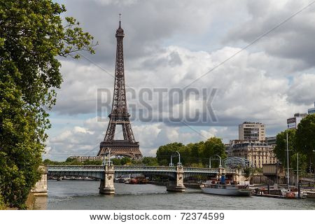 Seine River In Paris, With The Eiffel Tower In The Background.
