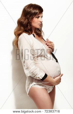 Beautiful Young Pregnant Woman Isolated Over White Background