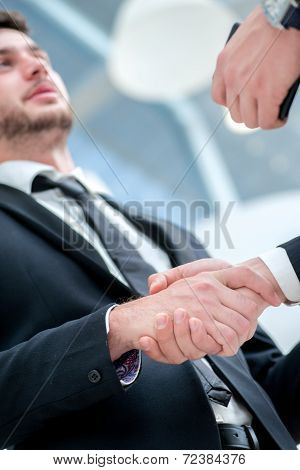 Shaking Hands. Two Confident Businessman Shaking Their Hands And Talking To Each Other While Standin