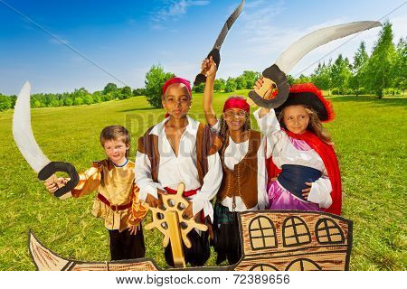 Happy pirate children and their captain with helm