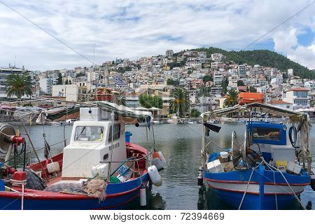 The Traditional Greek Fishing Boats In The Harbor Of Kavala In Greece. The Harbor Is The Focal Point