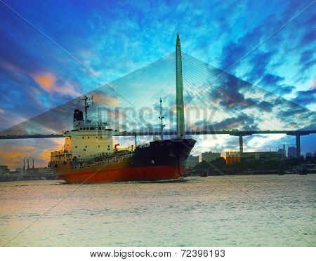 Tanker Ship In River Against Beautiful Bridge With Twilight Sky Of Urban Scene Use For Marine Transp