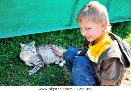 Little  Boy Stroking A Cat