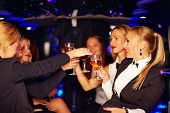 image of limousine  - group of beautiful women clinking glasses in limousine - JPG