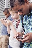 picture of bagpack  - Kids using smartphone after school - JPG