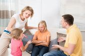stock photo of argument  - Angry Upset Family Having Argument At Home - JPG
