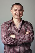 stock photo of woohoo  - Portrait of a positive man in striped shirt - JPG
