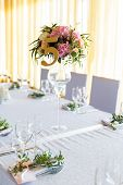 image of dowry  - Floral arrangement for decoration wedding table for guests. Room table. Vintage