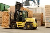 picture of fir  - Large lift truck moving a stack of green fir 2 x 4 lumber studs at a small log processing mill in southern Oregon ready for the drying kiln - JPG