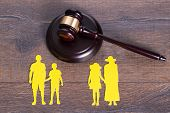 pic of divorce-papers  - Gavel on the table and paper family representing divorce - JPG