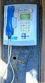 foto of phone-booth  - Old blue rusty public telephone in a public phone booth - JPG