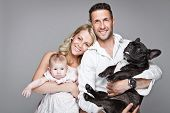 picture of dog teeth  - beautiful young family with little baby and dog isolated over grey background - JPG