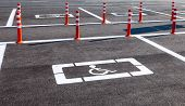 foto of physically handicapped  - Parking space reserved for handicapped shoppers in a retail parking lot - JPG
