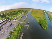 stock photo of airboat  - Airboat park and marina in the Florida Everglades aerial view - JPG
