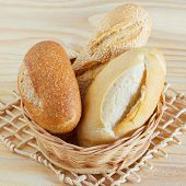 picture of baguette  - Brazilian french bread mini baguette integral with sesame in wicker basket - JPG