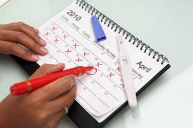 image of pregnancy test  - Hand circling calendar with pregnancy test on desk - JPG