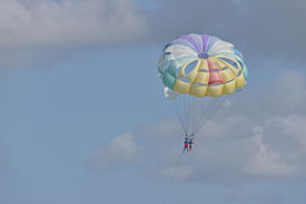 stock photo of parasailing  - Parasailing In Punta Cana - With Room For Copy Space To The Left ** Note: Visible grain at 100%, best at smaller sizes - JPG