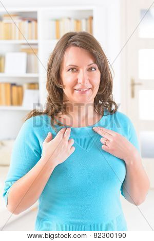 Woman doing EFT on the under collarbone. Emotional Freedom Techniques, tapping, a form of counseling intervention that draws on various theories of alternative medicine.