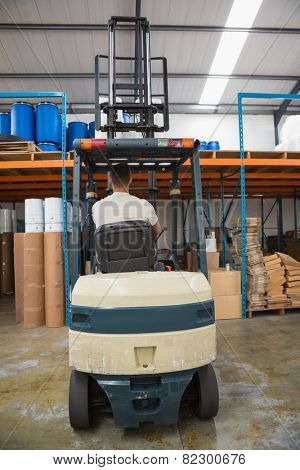 Rear view of forklift machine in warehouse