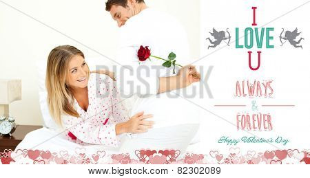 Attentive man giving a rose to his wife against i love you message